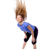 Young girl doing zumba fitness. Pretty girl in dancing pose with disheveled hair. Female fitness/ aerobics trainer during dance class. Isolated on white Stock Images