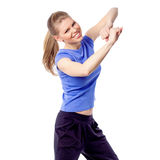 Young girl doing zumba fitness. Young smiling instructor doing aerobics dance, isolated on white background. Happy active Caucasian woman enjoying fitness Stock Images