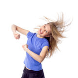 Young girl doing zumba fitness. Fitness trainer in motion, isolated on white. Pretty young woman moving with energy and joy. Isolated on white background Stock Photography