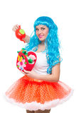 Young girl doll with blue hair. watering Royalty Free Stock Photography