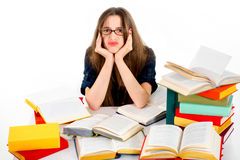 Young girl don't want to study, she is tired, siting in surround Stock Photo