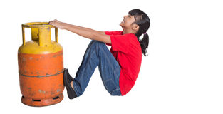 Young Girl Dragging Cooking Gas Cylinder II Stock Photography