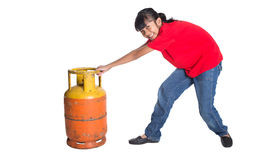 Young Girl Dragging Cooking Gas Cylinder III Royalty Free Stock Photography