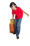 Young Girl Dragging Cooking Gas Cylinder VI Stock Images