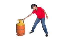 Young Girl Dragging Cooking Gas Cylinder VII Stock Photos