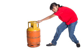 Young Girl Dragging Cooking Gas Cylinder VIII Royalty Free Stock Image