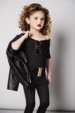 Young girl draping jacket over shoulder Royalty Free Stock Image