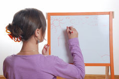 Young girl drawing Royalty Free Stock Photography