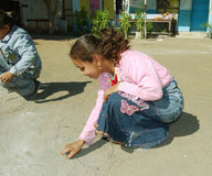 Young girl drawing with chalk at school Stock Photography