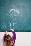 Young girl drawing on chalkboard Royalty Free Stock Photo