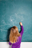 Young girl drawing on chalkboard Stock Photography