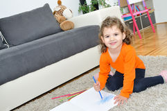 Young girl drawing Royalty Free Stock Photo