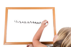 Young girl drawing on a dry erase board Royalty Free Stock Photography
