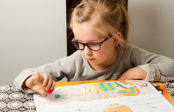 Young girl drawing Stock Images