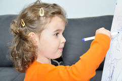 Young girl drawing Stock Photography