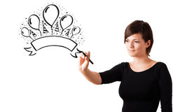 Young girl drawing a party label on whiteboard Royalty Free Stock Photo