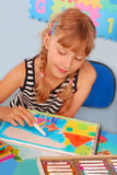 Young girl drawing a picture of family Royalty Free Stock Image