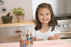 Young Girl Drawing Pictures Stock Image
