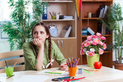 The young girl drawing pictures at home Royalty Free Stock Photos