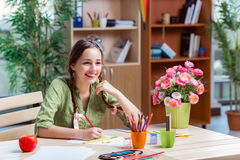 The young girl drawing pictures at home Royalty Free Stock Photo