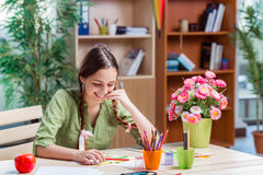 The young girl drawing pictures at home Stock Photo
