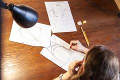Young women drawing sketch. Design of backpack stock photography
