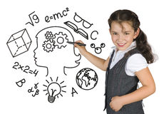 Young girl drawing on white board. School education concept.  Stock Photos