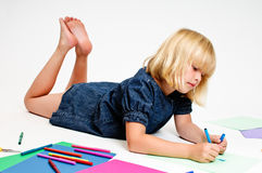 Young girl draws Stock Photos
