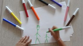 Young girl draws a family stock video
