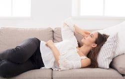 Young girl dreaming on sofa stock photo