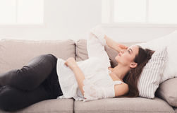 Young girl dreaming on sofa Royalty Free Stock Photos