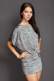 Young girl in dress on gray background Royalty Free Stock Photography