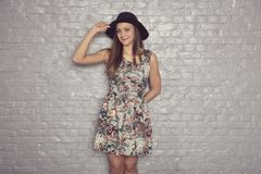 Young girl in a dress with a hat on her head. Young girl in a dress, with a hat on her head Royalty Free Stock Image