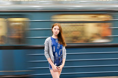 Young girl in a dress travels at subway. Young woman waiting at subway station Stock Photography