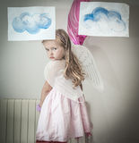 Young girl dressed as angel Royalty Free Stock Images