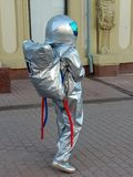 A young girl dressed as an astronaut distributes ads on a pedestrian street in the city. Promotion of services. Russia royalty free stock photo