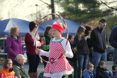 Young girl dressed as a candy cane and performing with hula hoop in annual Holiday Parade, Glens Falls, New York, 2014. Young smiling girl dressed as a candy royalty free stock photography