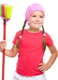 Young girl is dressed as a cleaning maid Royalty Free Stock Photography