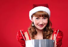 Young girl dressed as Santa Claus Stock Photos
