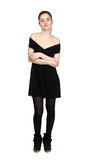 Young girl dressed in casual black dress and black sneakers Royalty Free Stock Photo