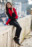 Young girl dressed in casual chinos, black sneakers Stock Photo