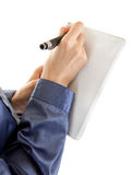 A young girl dressed in office wrote in a notebook Royalty Free Stock Photography