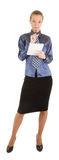 A young girl dressed in office wrote in a notebook Stock Images
