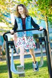 Young girl dressed in skirt exercise running a gym machine outdoor stock photography