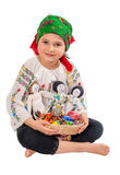 Girl with Easter Eggs. Young girl dressed in traditional costume holding a basket with Eastern eggs and hand made dolls stock photo