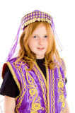 Young girl dressed up in an arabian suit royalty free stock photography