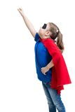 Young girl dressed up as superhero with mask and Stock Image