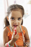 Young Girl Dressing Up And Putting On Make Up Royalty Free Stock Photos