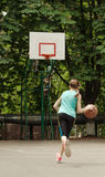 Young girl dribbling a basketball Stock Image