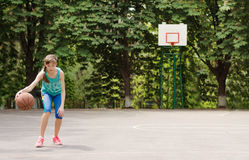 Young girl dribbling a basketball Royalty Free Stock Images